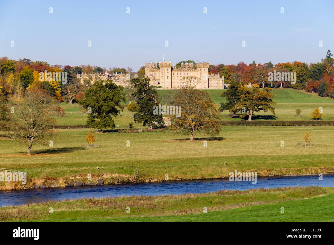 Floors Castle and grounds in autumn from across River Tweed. Kelso Berwickshire Scottish Borders Scotland UK Britain - Stock Image