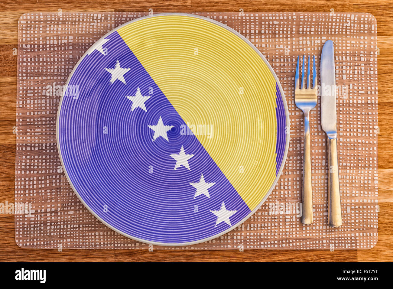 Dinner plate with the flag of Bosnia and Herzegovina on it for your international food and drink concepts. - Stock Image