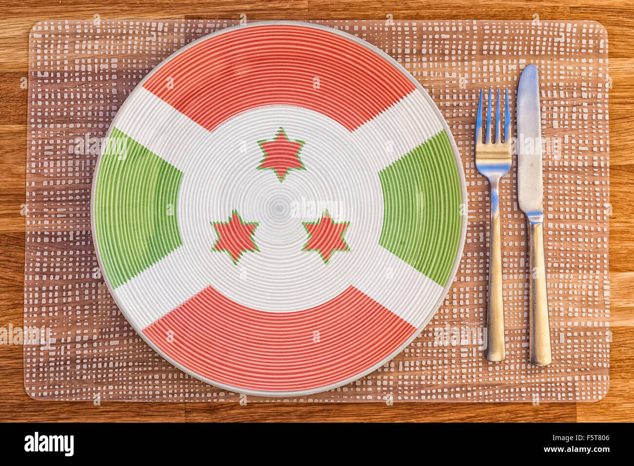 Dinner plate with the flag of Burundi on it for your international food and drink concepts. - Stock Image