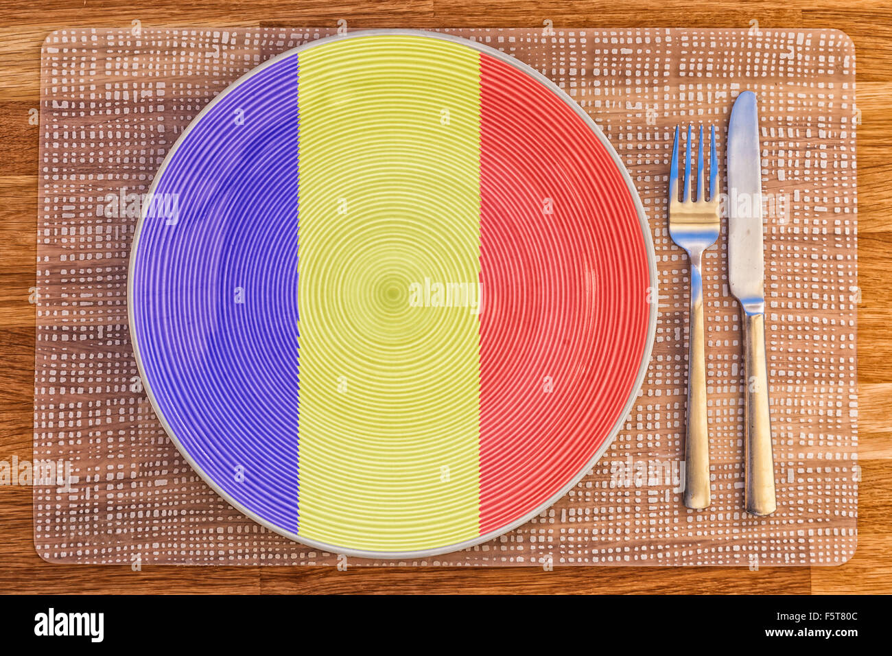 Dinner plate with the flag of Chad on it for your international food and drink concepts. Stock Photo