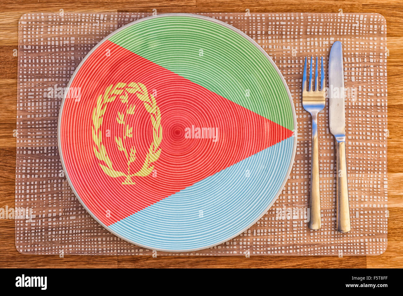 Dinner plate with the flag of Eritrea on it for your international food and drink concepts. - Stock Image
