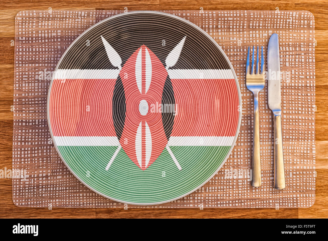 Dinner plate with the flag of Kenya on it for your international food and drink concepts. Stock Photo