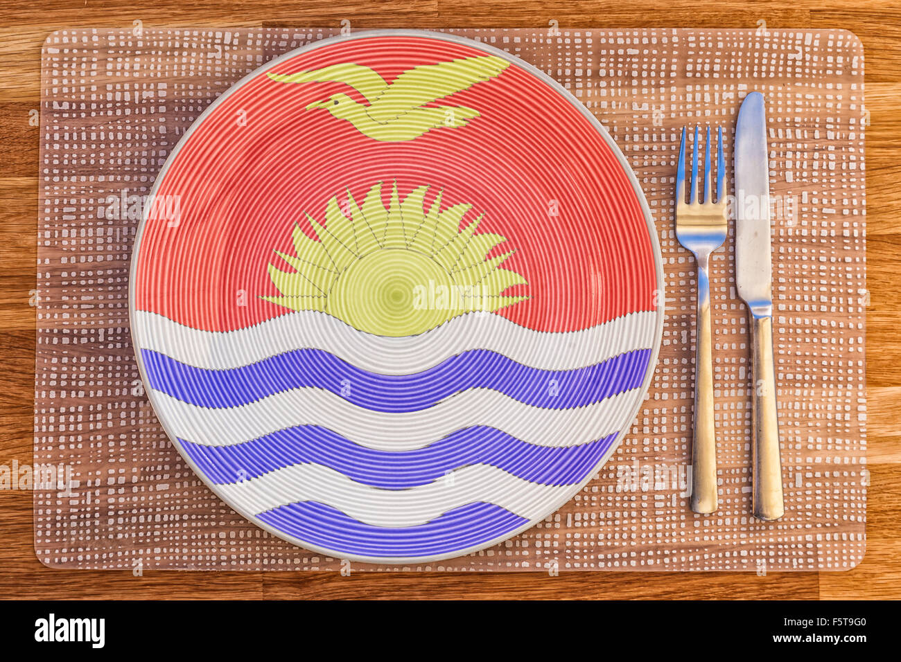 Dinner plate with the flag of Kiribati on it for your international food and drink concepts. - Stock Image