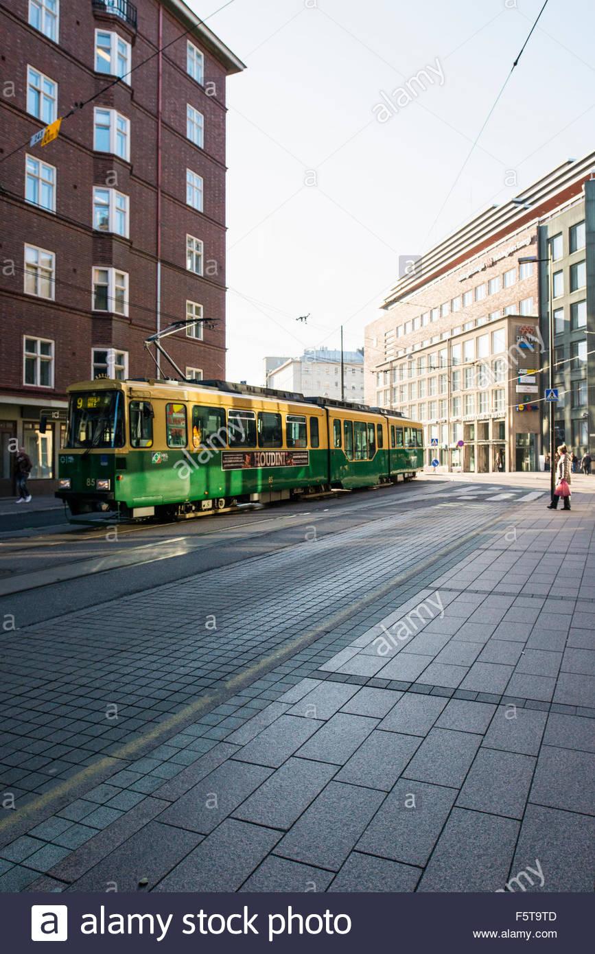 Finland, Uusimaa, Helsinki, Kamppi, Tram in street - Stock Image