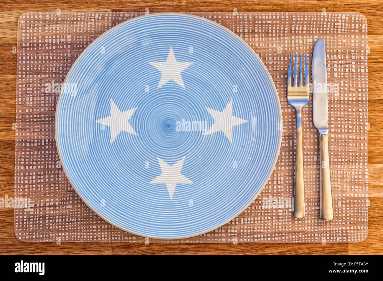 Dinner plate with the flag of Micronesia on it for your international food and drink concepts. - Stock Image