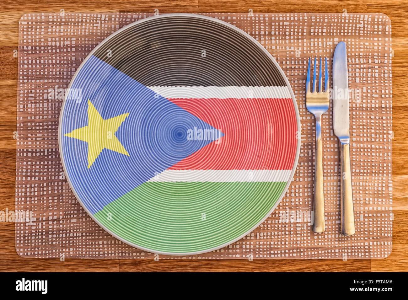 Dinner plate with the flag of South Sudan on it for your international food and drink concepts. - Stock Image