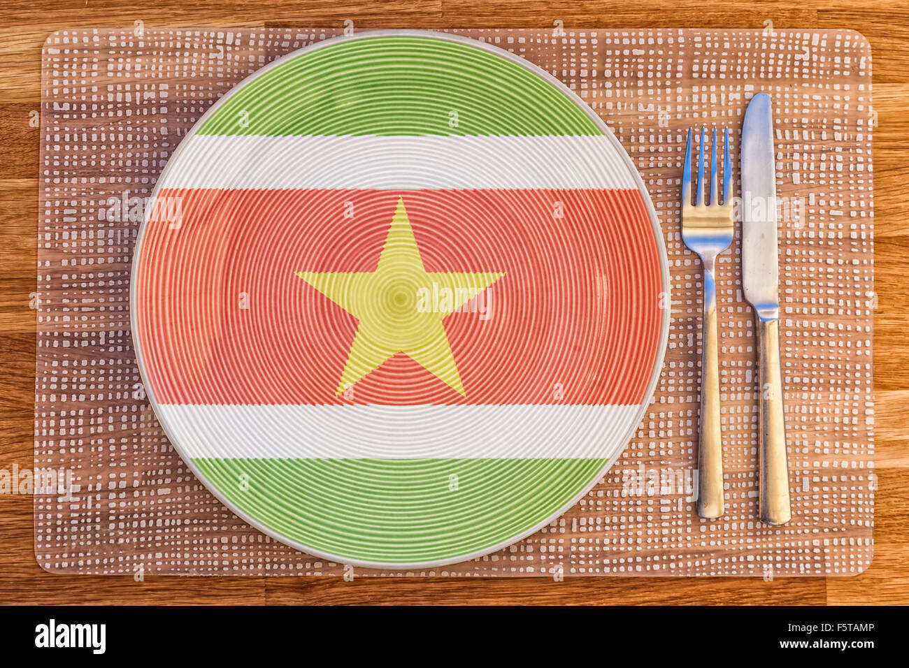 Dinner plate with the flag of Suriname on it for your international food and drink concepts. - Stock Image