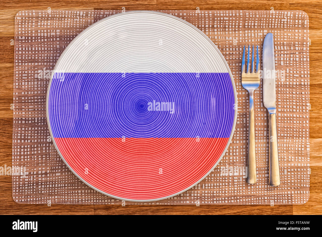 Dinner plate with the flag of the Russian Federation on it for your international food and drink concepts. - Stock Image