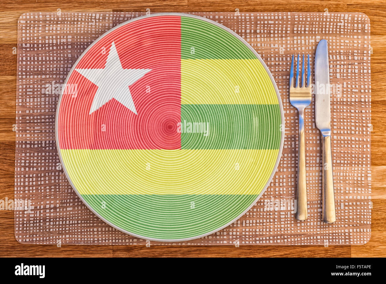 Dinner plate with the flag of Togo on it for your international food and drink concepts. - Stock Image