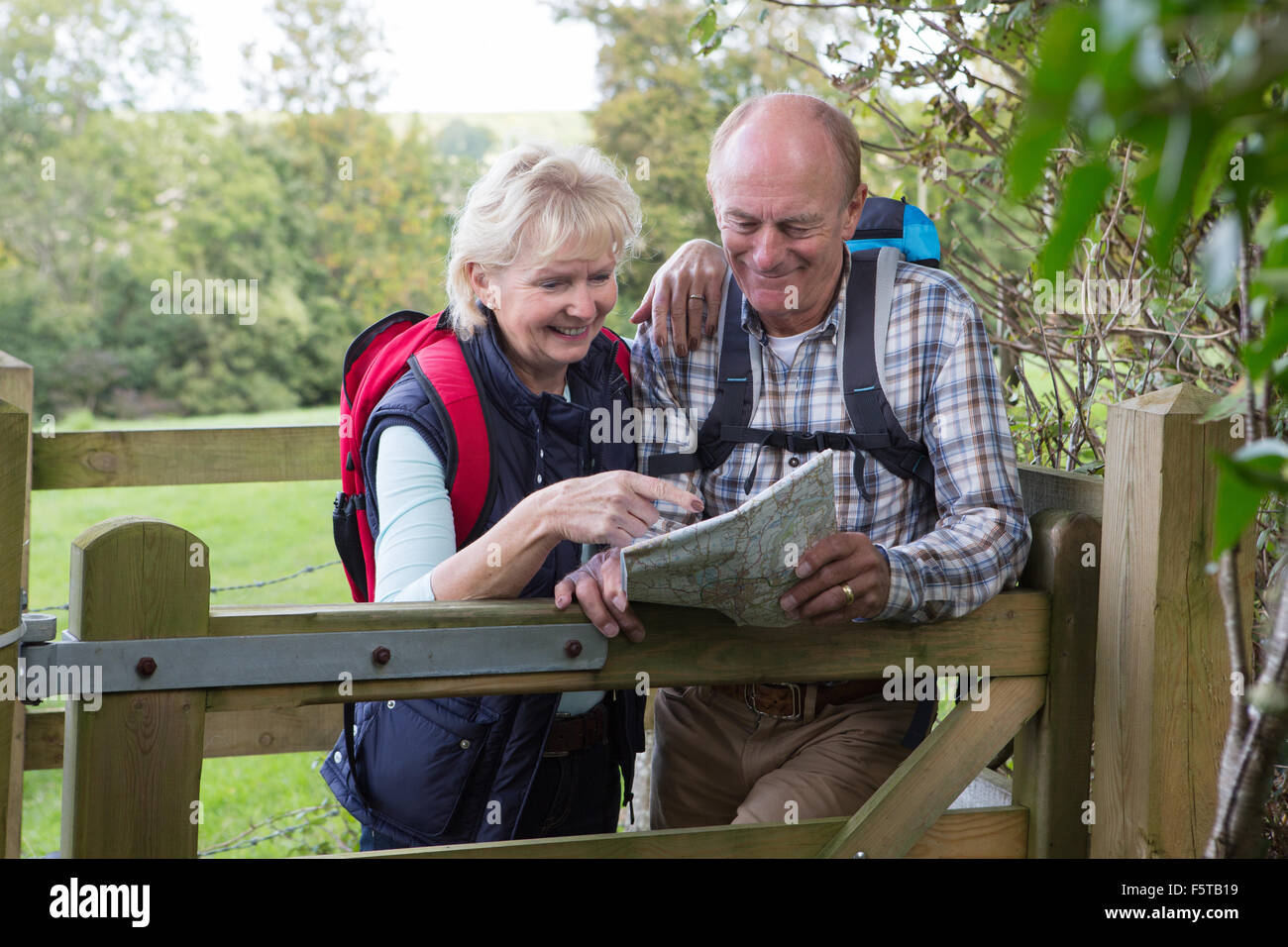 Active Senior Couple On Walk In Countryside Stock Photo