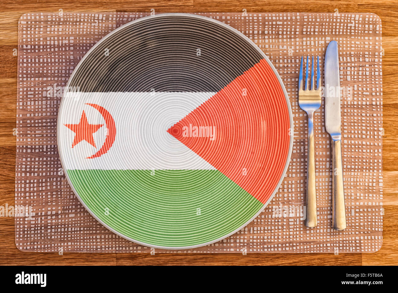 Dinner plate with the flag of Western Sahara on it for your international food and drink concepts. - Stock Image