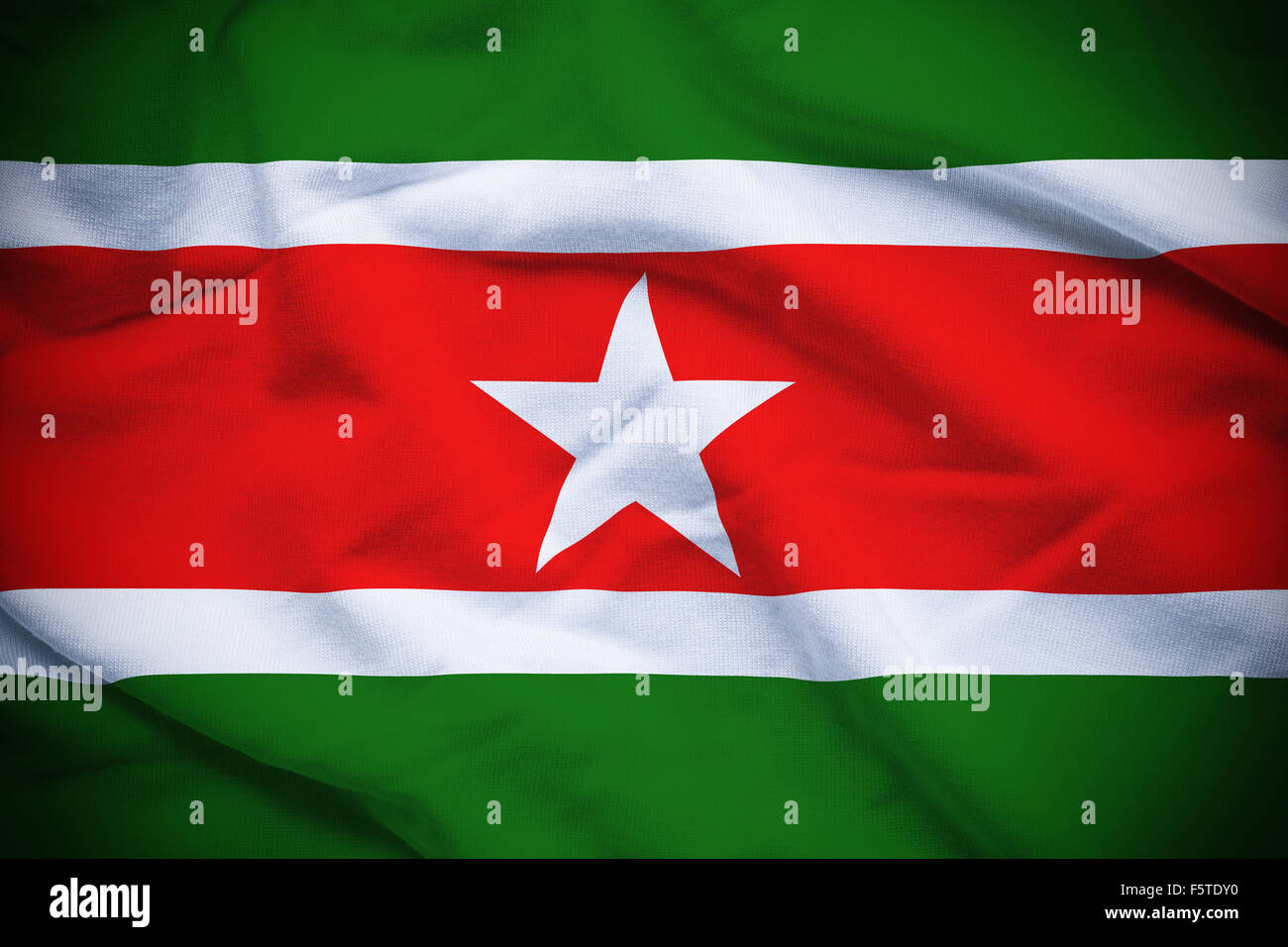Wavy and rippled national flag of Suriname background. - Stock Image