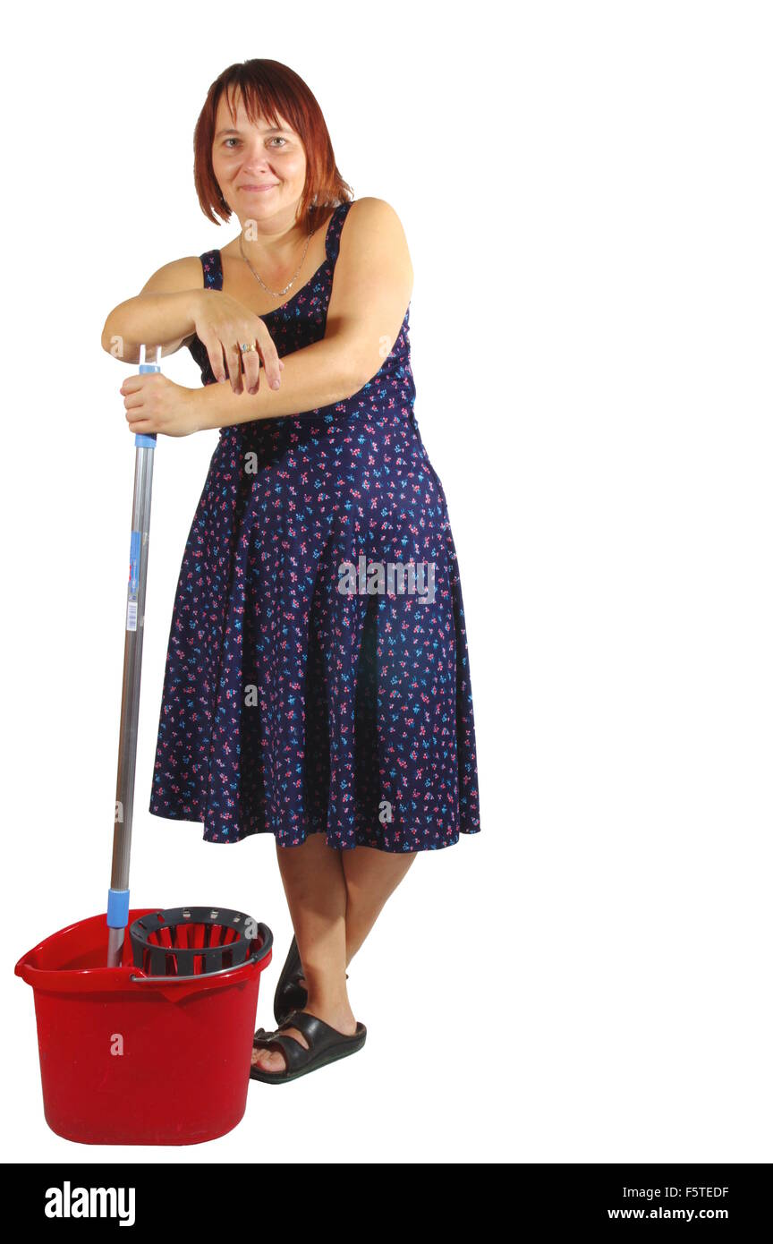 Housekeeper cleans the floor. Woman washes the floor with mop. On a white background,  isolated. Stock Photo