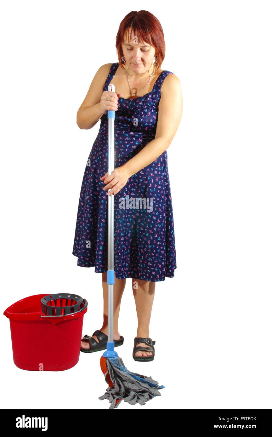 Housekeeper cleans the floor. Woman washes the floor with mop. On a white background,  isolated. - Stock Image