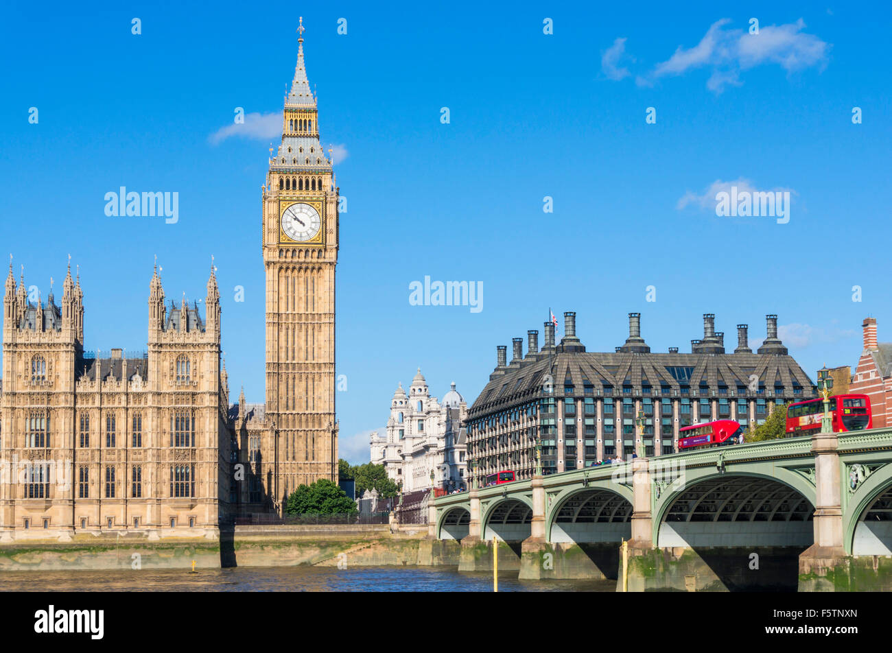 Big Ben clock tower Houses of Parliament and Westminster bridge over the River Thames City of London England GB - Stock Image