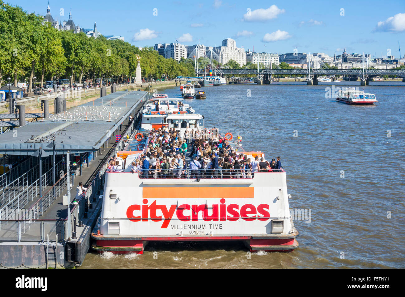 River Thames cruise boats on the Bank of the River Thames London England GB UK EU Europe - Stock Image