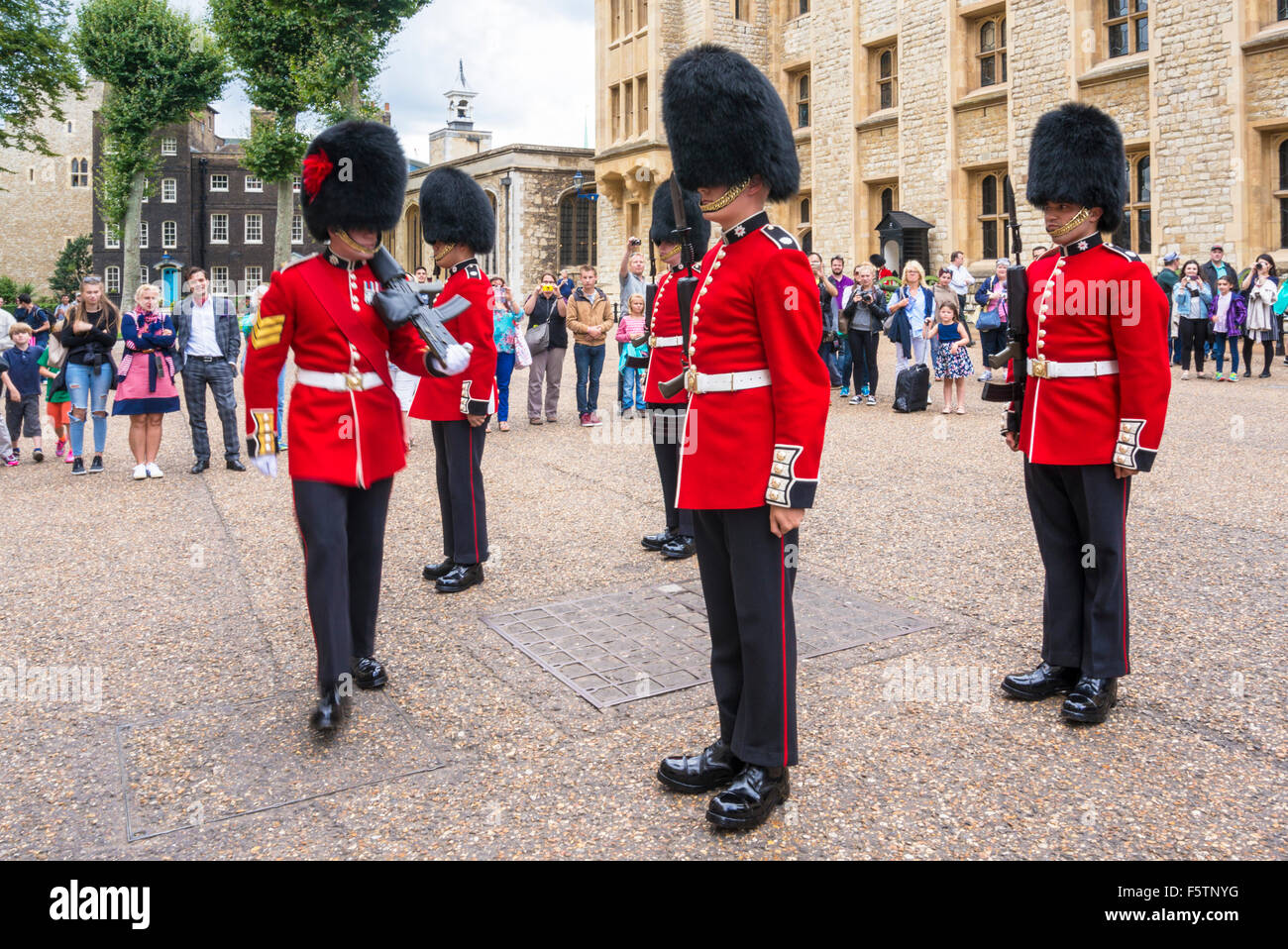 Coldstream guards being inspected Changing the guard at the Jewel house Tower of London City of London England GB - Stock Image