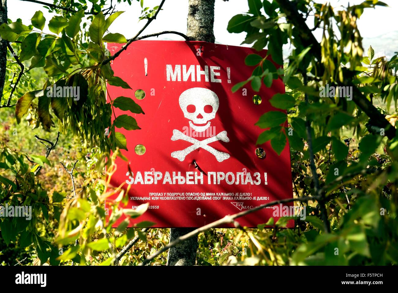 Land mine warning sign on the boder of Republika Srpska and Federation of Bosnia and Herzegovina near Zavala in - Stock Image