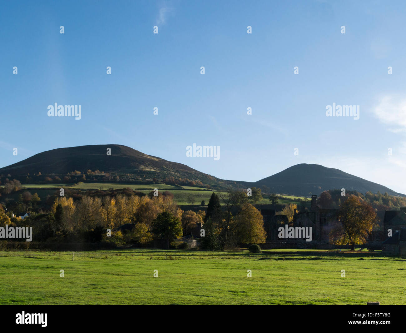 View from historic Melrose town to shapely summits of the Eildon Hills the best known landmark in Scottish Borders - Stock Image
