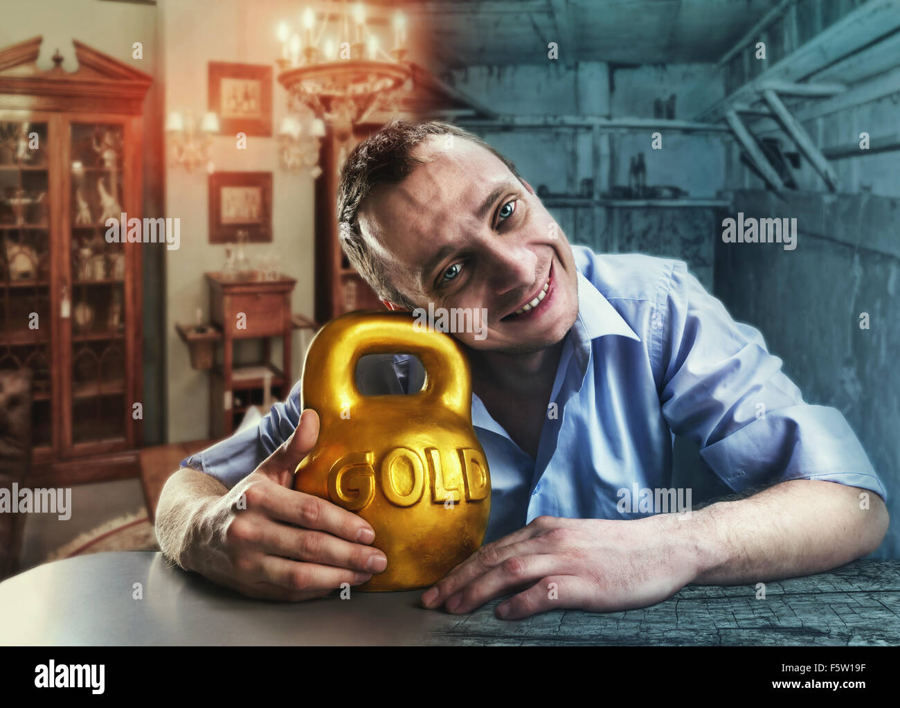 Happy man hugs a gold kettlebell in rich and poor home interior - Stock Image