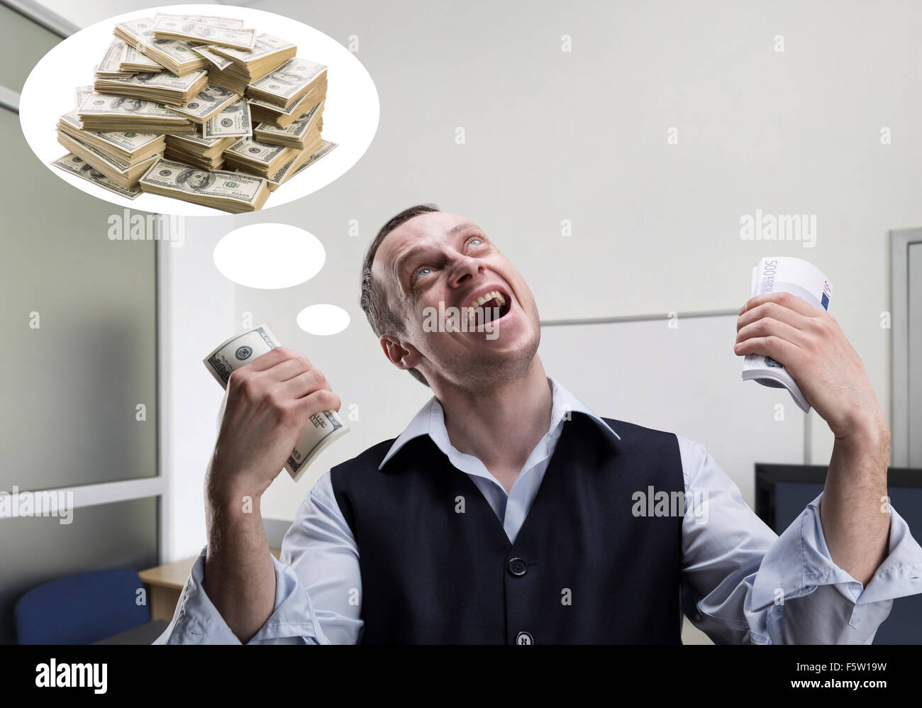 Cheerful businessman holds money and dreams in the office - Stock Image