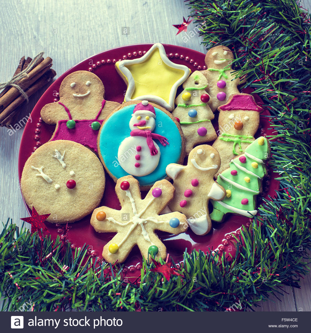 christmas cookies decorated with fondant on table stock image