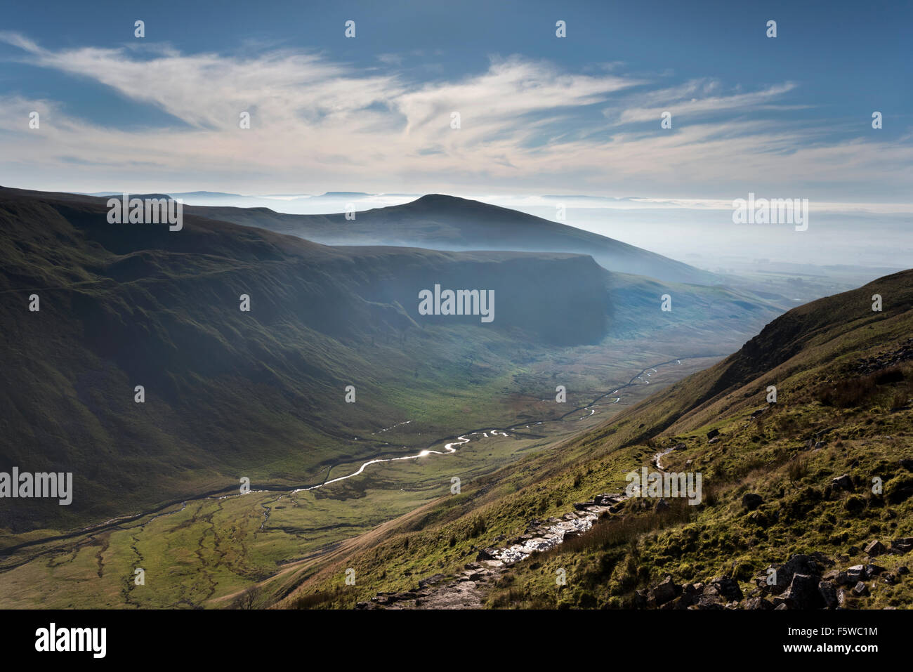 A misty Autumn day seen from the Pennine Way National Trail at High Cup Nick, near Appleby, Cumbria, UK - Stock Image