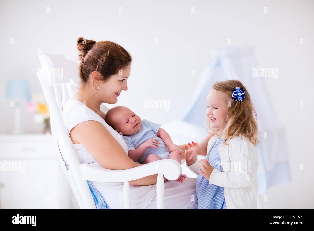 c8bf66ee695af Little sister hugging her newborn brother. Toddler kid meeting new ...