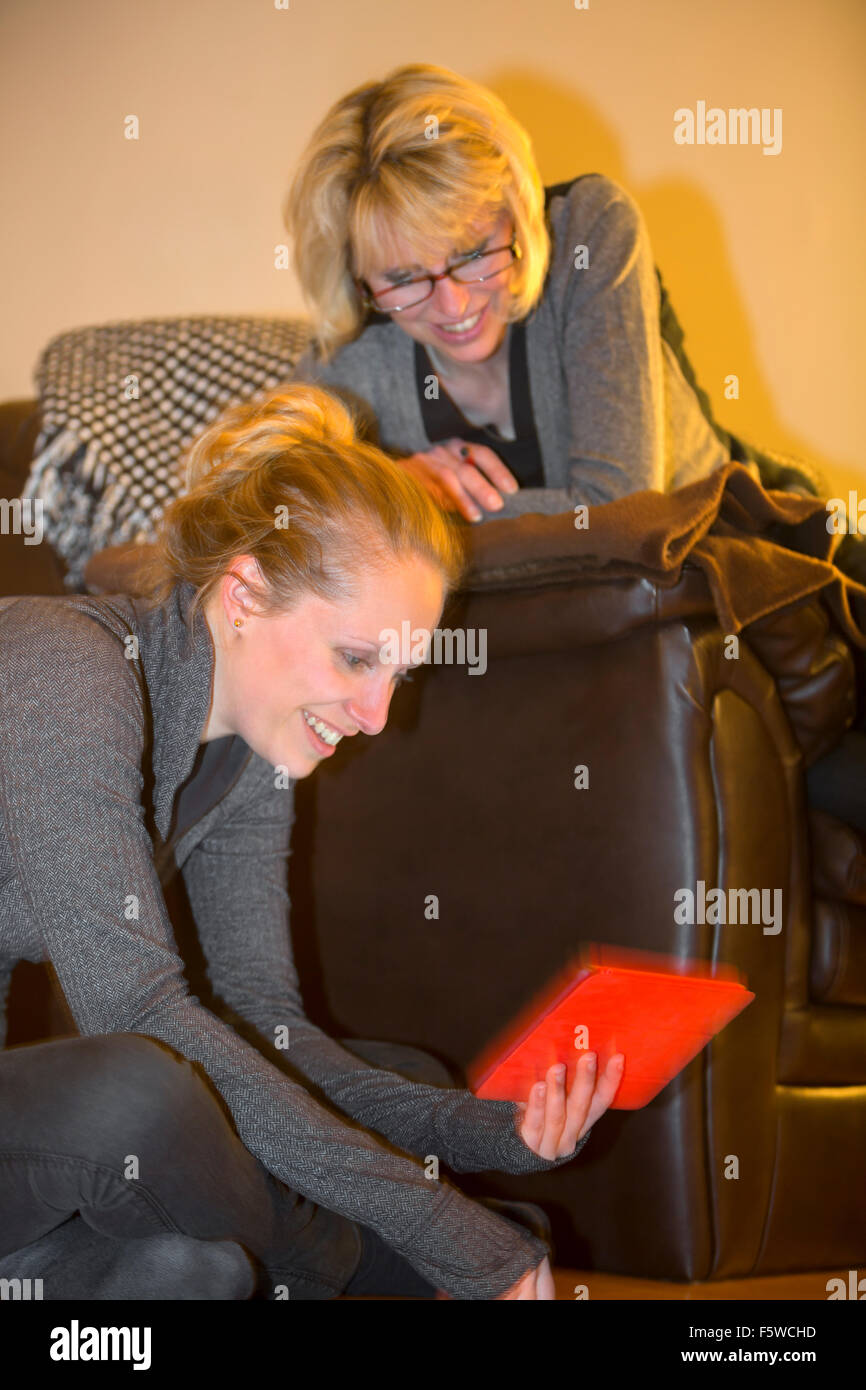two women using digital tablet computer - Stock Image