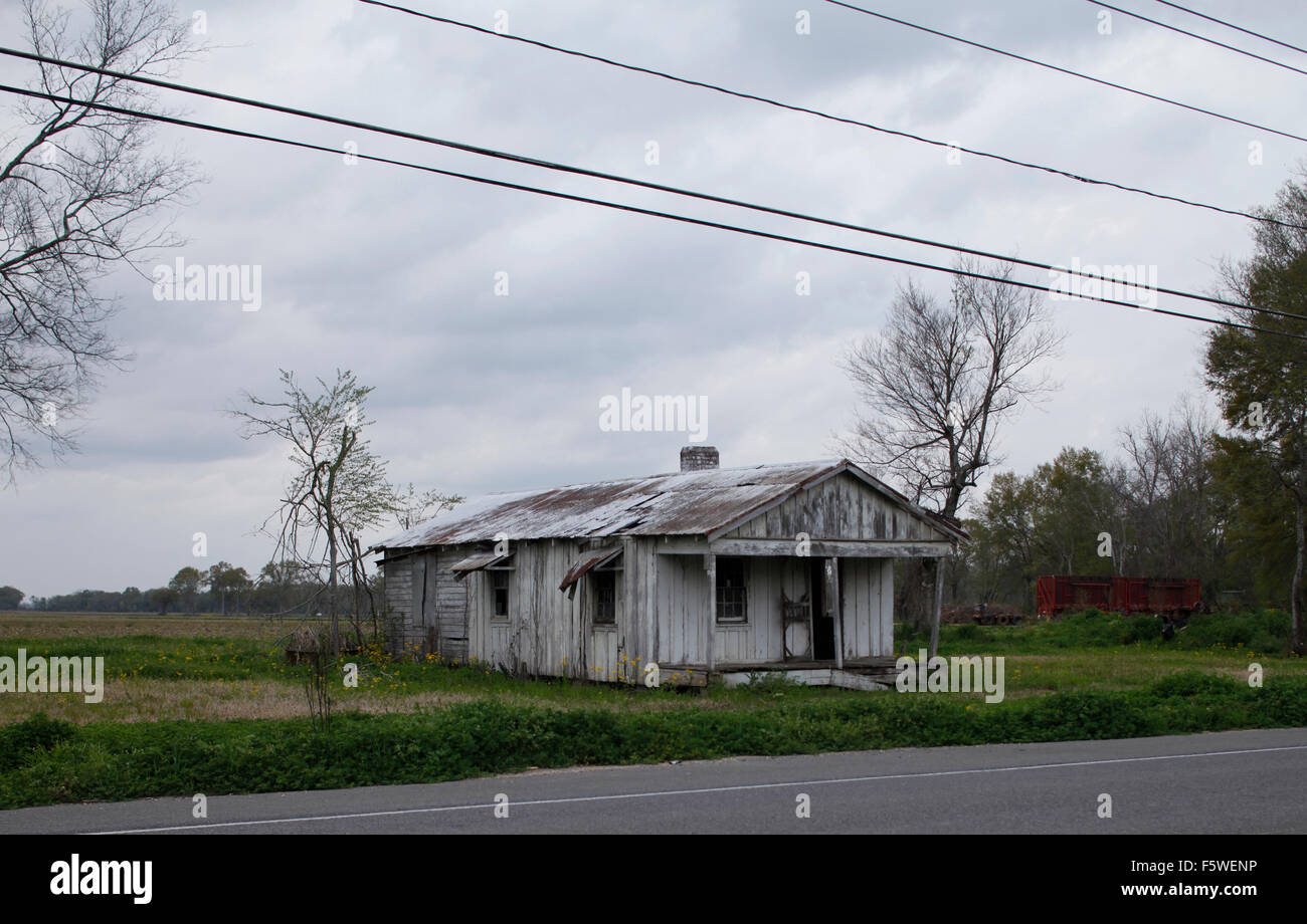 Run down house, peeling paint, Louisiana - Stock Image