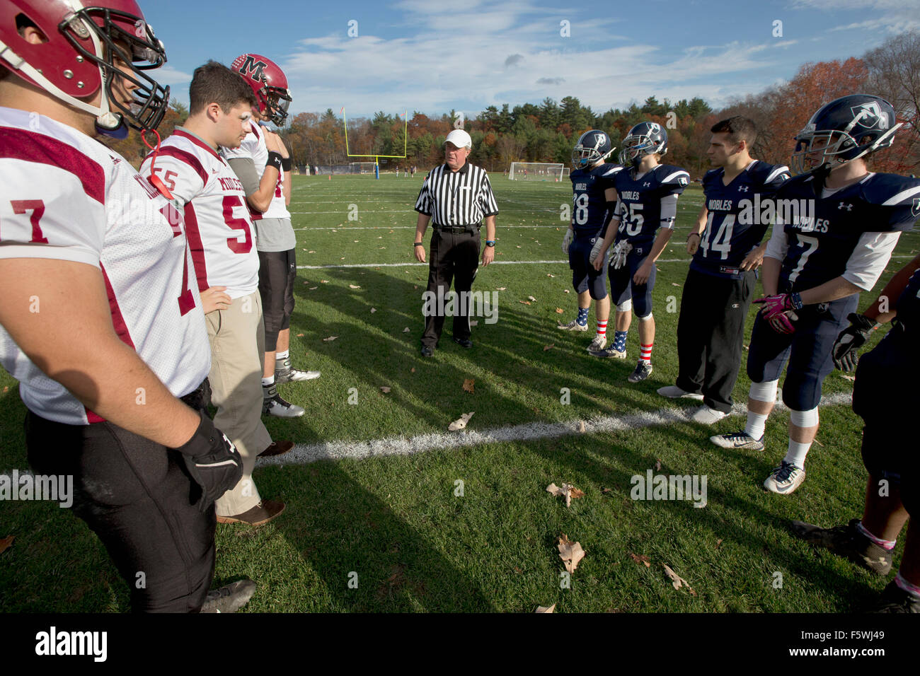 High School football players with a referee - Stock Image