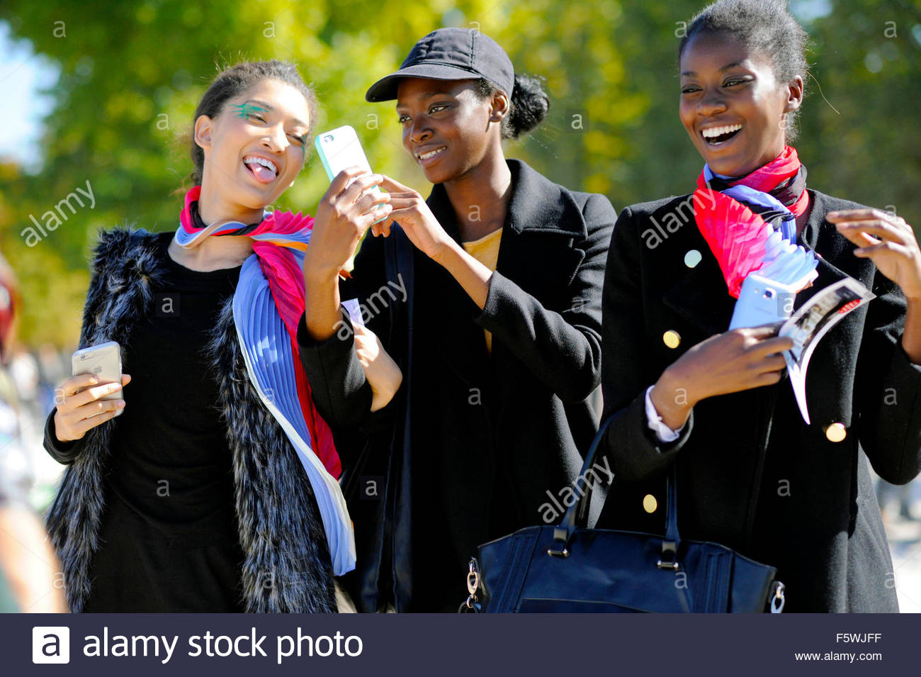 Models Off duty after Issey miyake SS16 ready to wear fashion show at the Jardin des  Tuileries, Paris Fashion Week - Stock Image