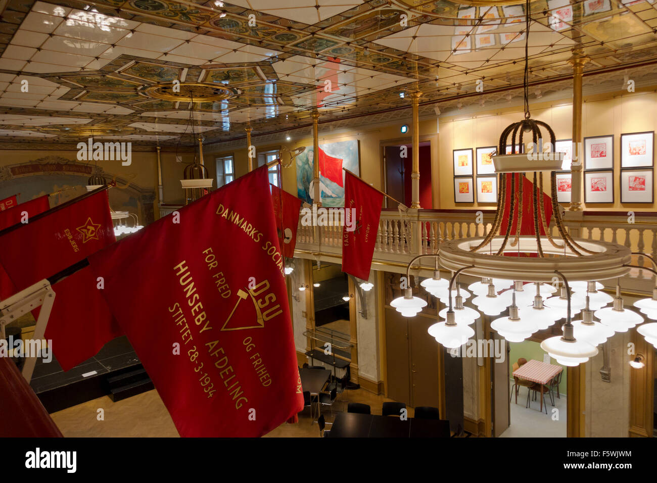 The historic assembly hall with the trade unions'  red banners in the Workers Museum (Arbejdermuseet) Copenhagen. - Stock Image
