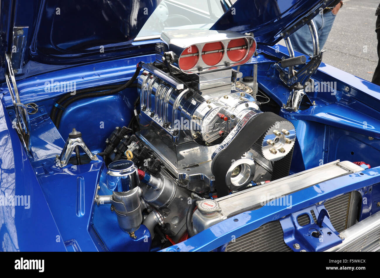 A Custom Supercharged Engine at a car show Stock Photo