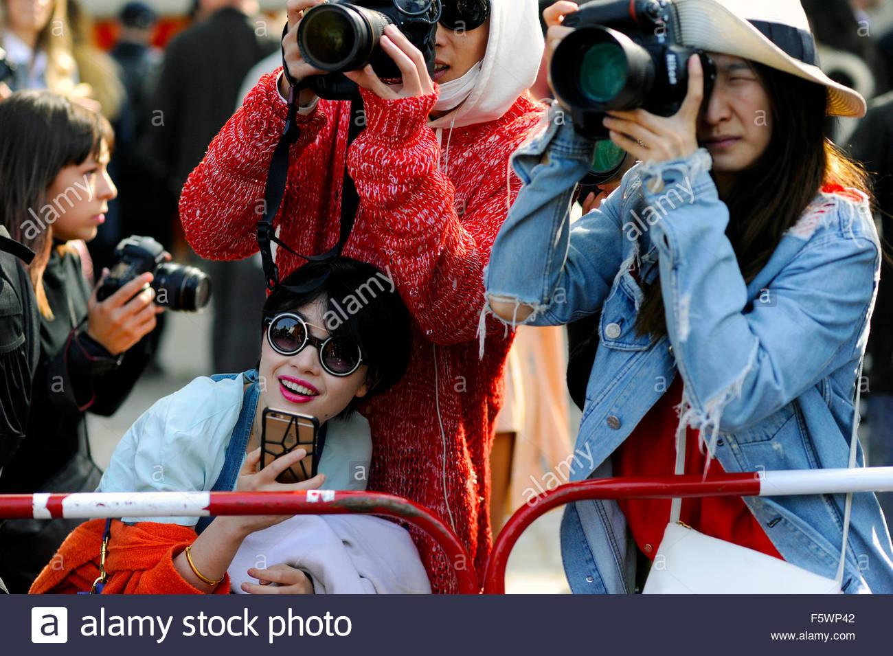 Street Style photographers on Avenue Félix d'Herelle, snapping the exit after Celine Ready to Wear, Paris - Stock Image