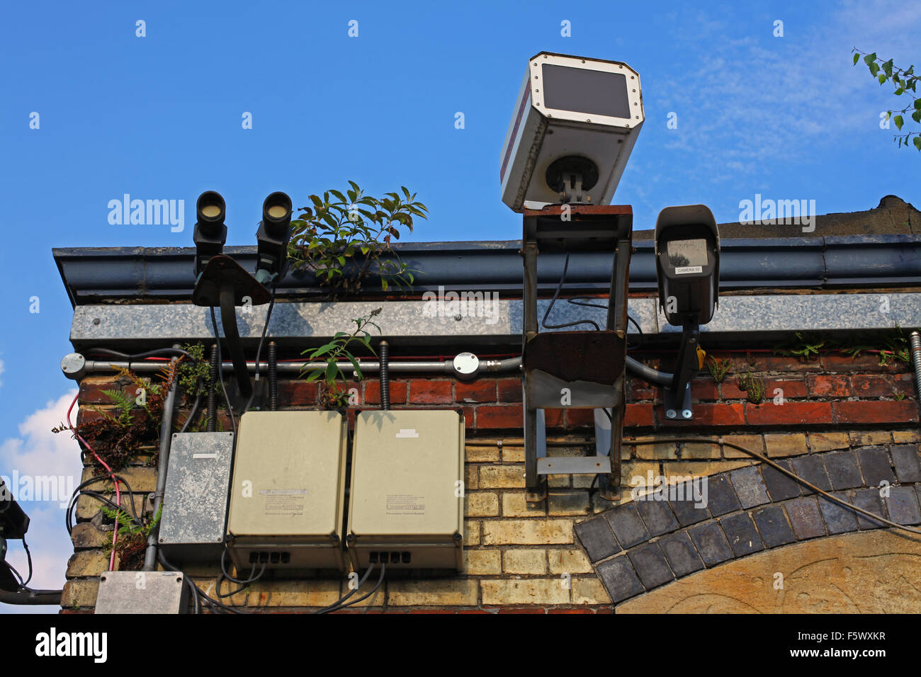 laser  microwave  camera CCTV receivers transmitters all mounted on the side of a building looking over us all - Stock Image