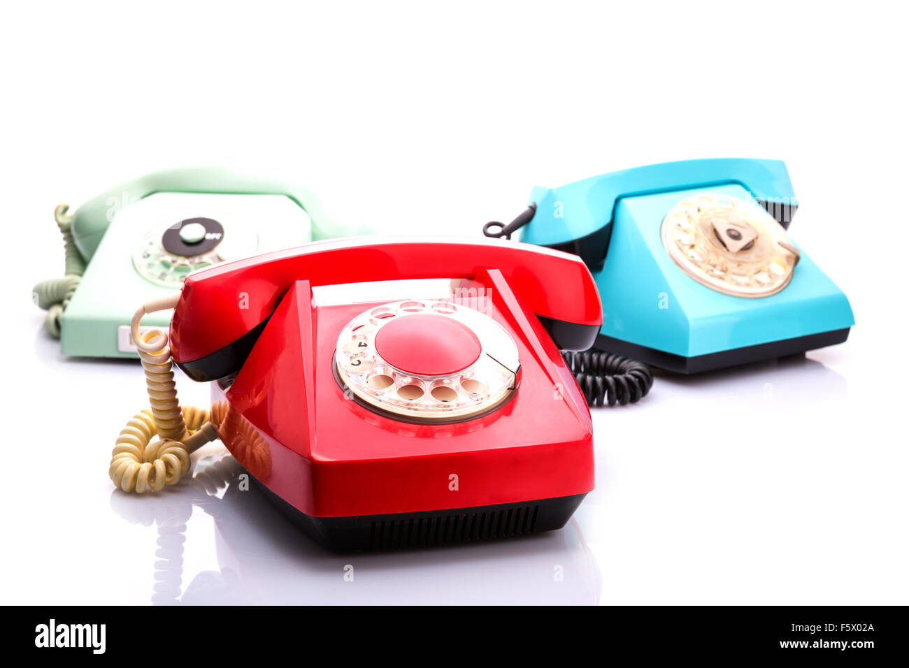 Set of vintage telephones isolated on white background - Stock Image