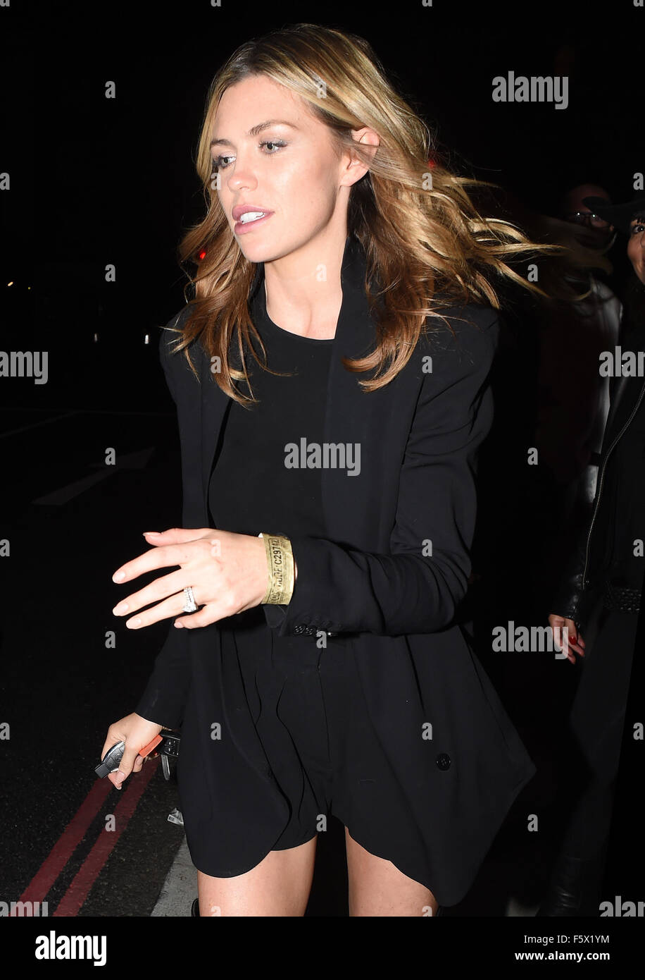 d633f19cc69 Abbey Clancy flashing her long legs in her knee high length leather boots  as she climbed into a waiting taxi with husband Peter Crouch at Koko Camden.
