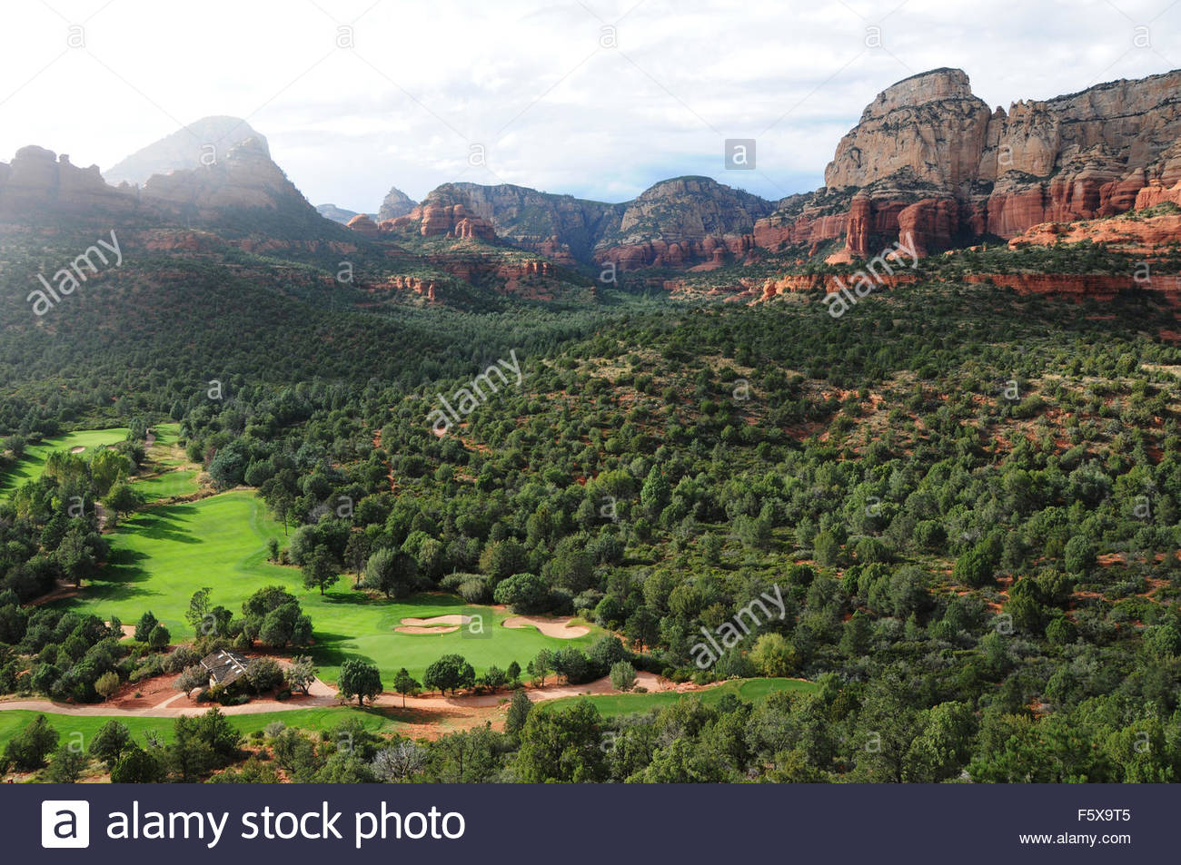 Light and clouds and rain above the Seven Canyons golf resort in Sedona, Arizona - Stock Image