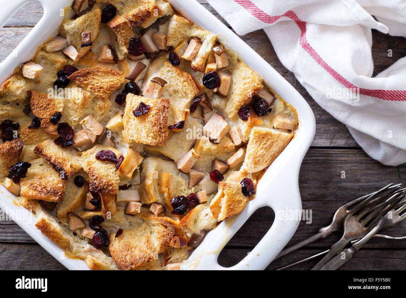 Bread pudding breakfast casserole with pear and dried cranberry - Stock Image
