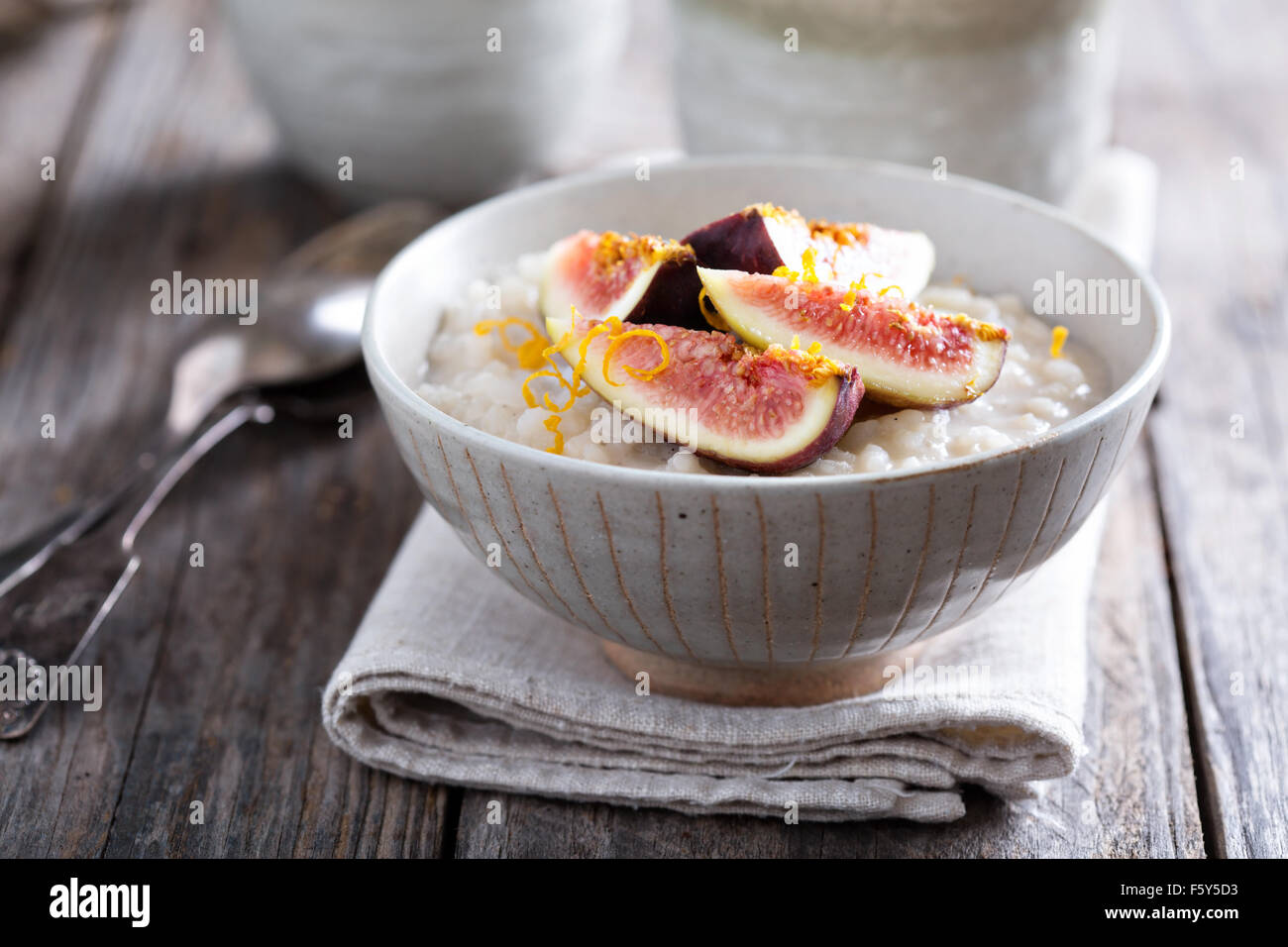 Rice pudding with vanilla, orange zest and fresh figs - Stock Image