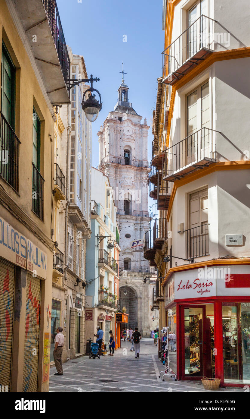 view of the steeple of Iglesia San Juan through Calle San Juan in the historic center of Malaga, Andalusia, Spain - Stock Image