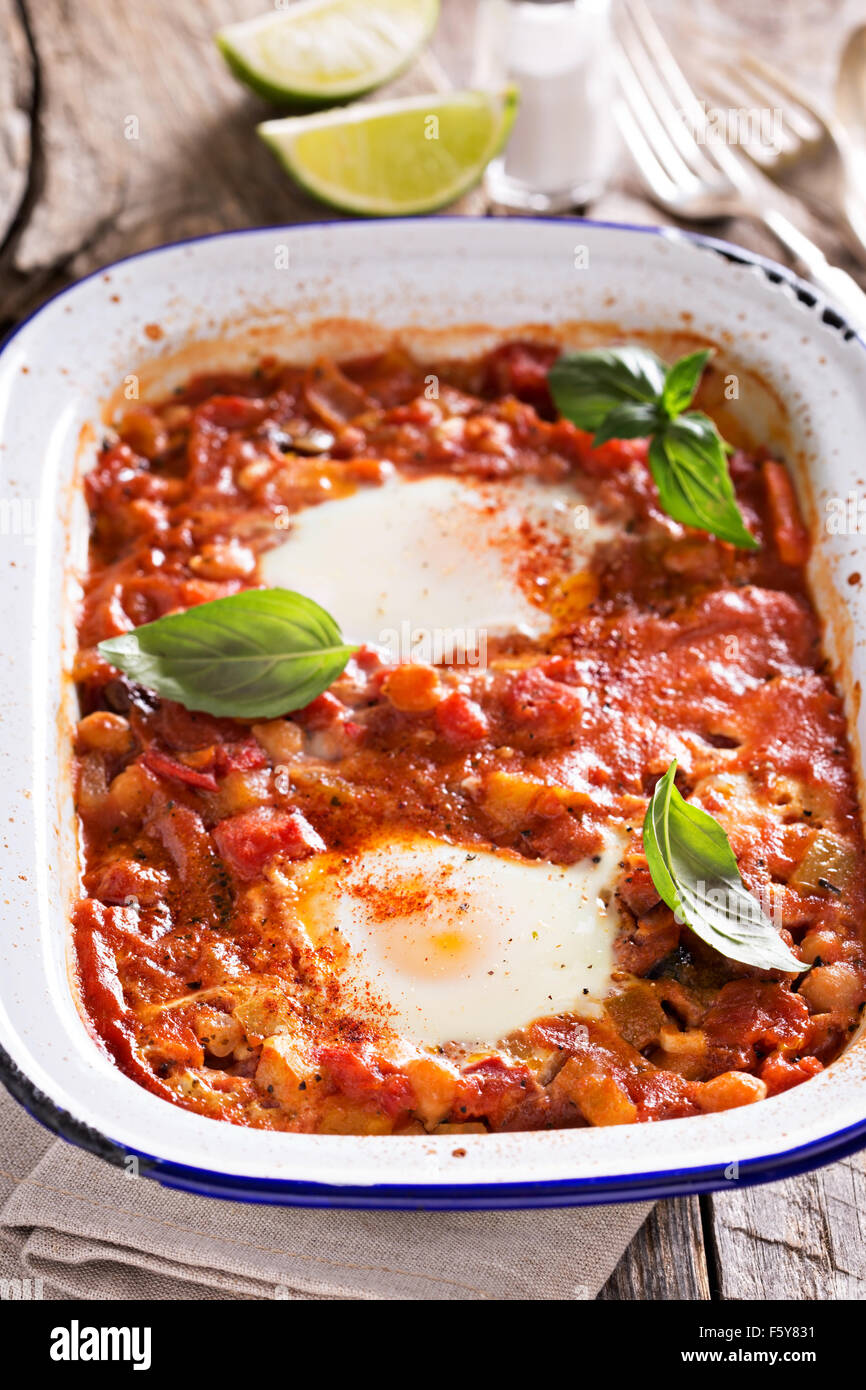 Huevos rancheros baked eggs with tomato sauce and chickpeas - Stock Image