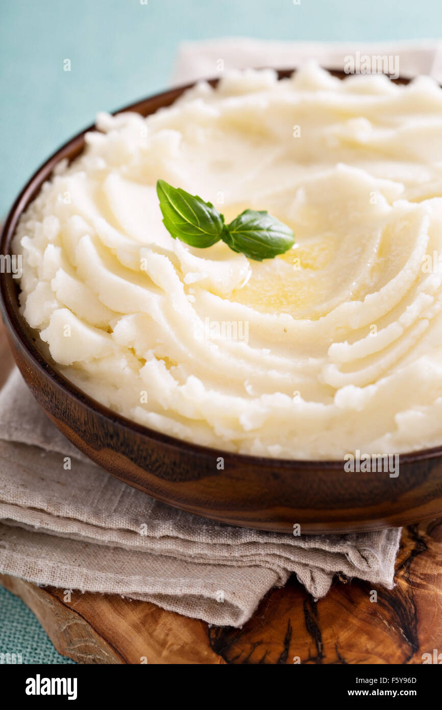 Mashed potatoes in a big wooden bowl - Stock Image
