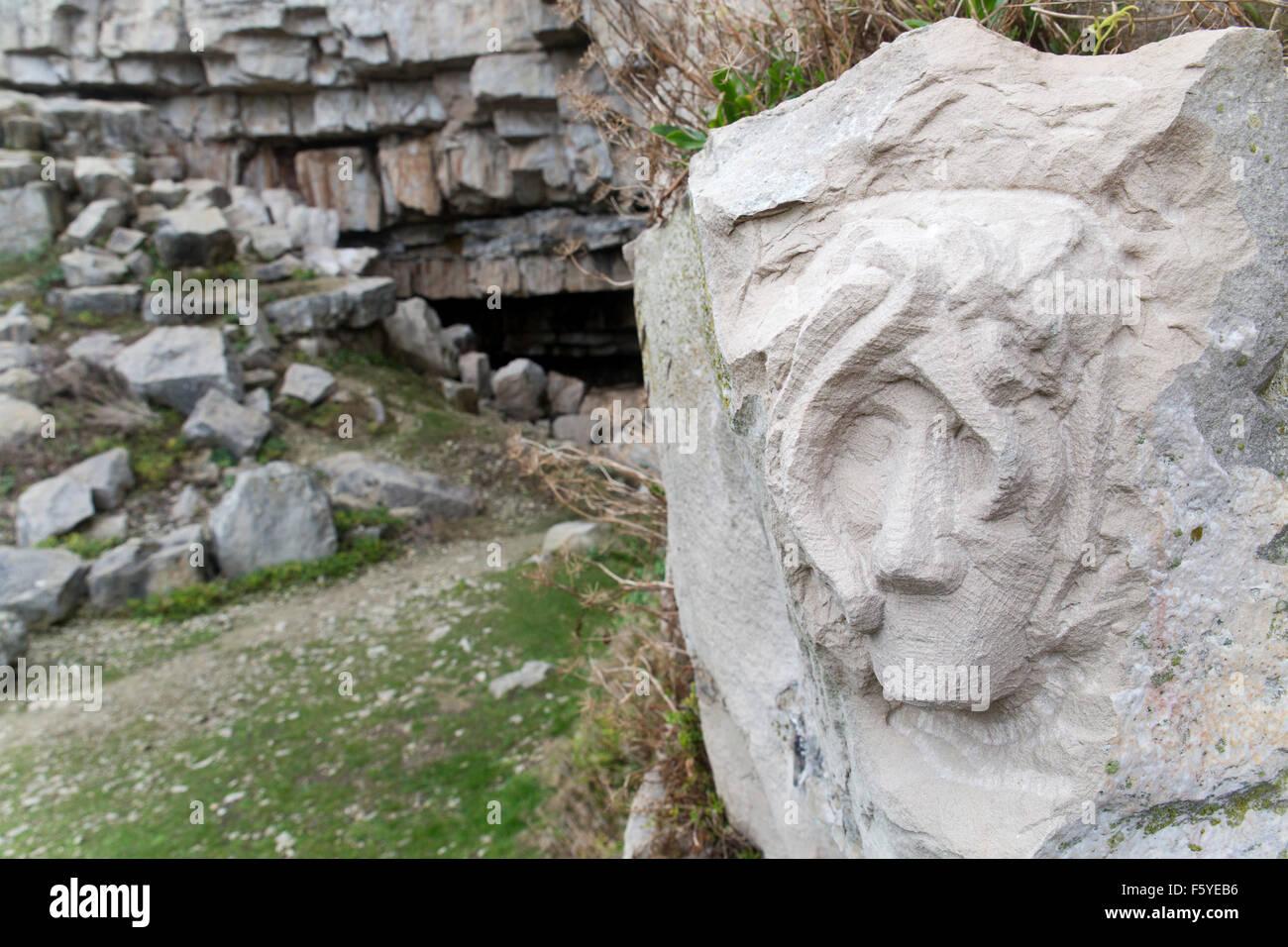 Carving of a Head; Winspit Quarry Worth Matravers; Dorset; UK - Stock Image