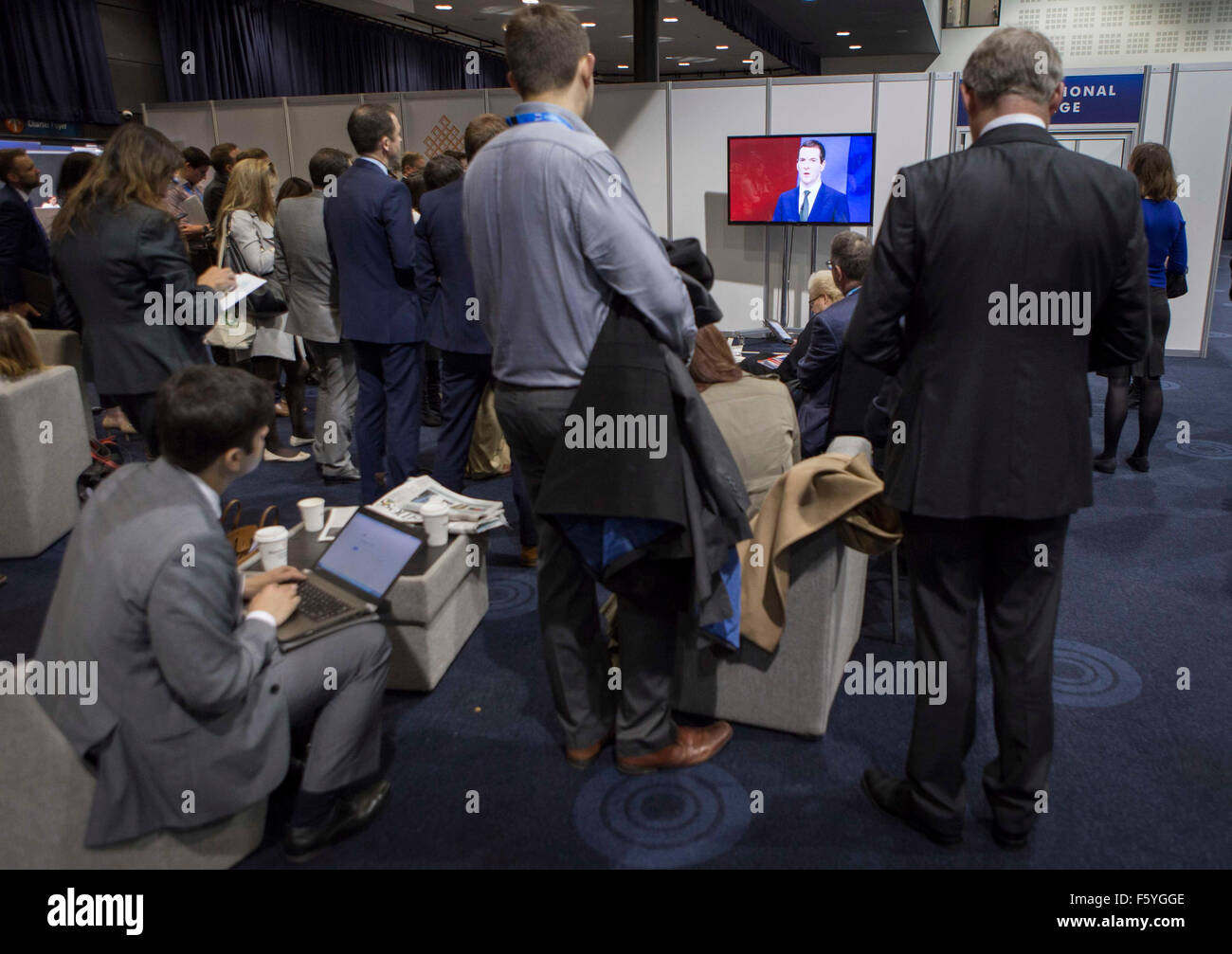 Conservative Party Conference 2015. George Osborne delivers his keynote speech  Journalists watch the speech in - Stock Image