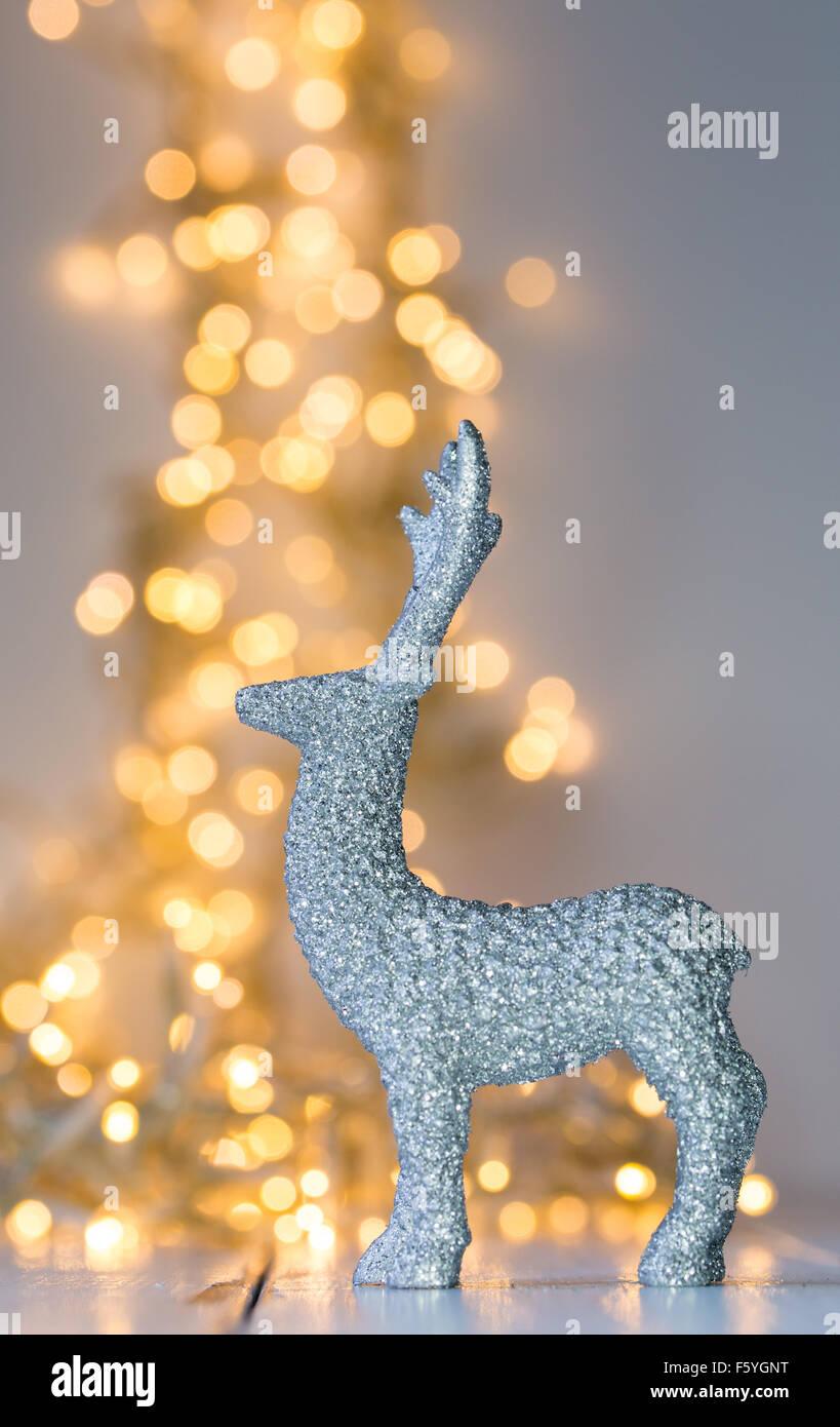 Silver deer in front of Christmas lightening - Stock Image