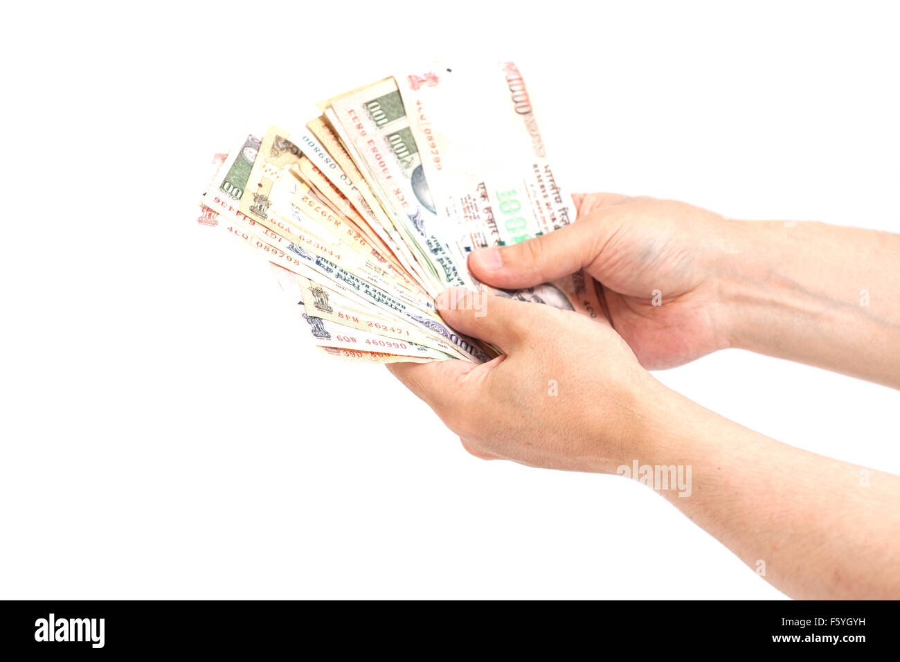 Hand with Indian rupee notes isolated - Stock Image