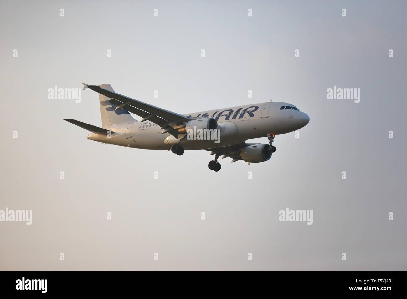 Finnair Airbus A319-112 OH-LVC landing at Heathrow Airport, London - Stock Image
