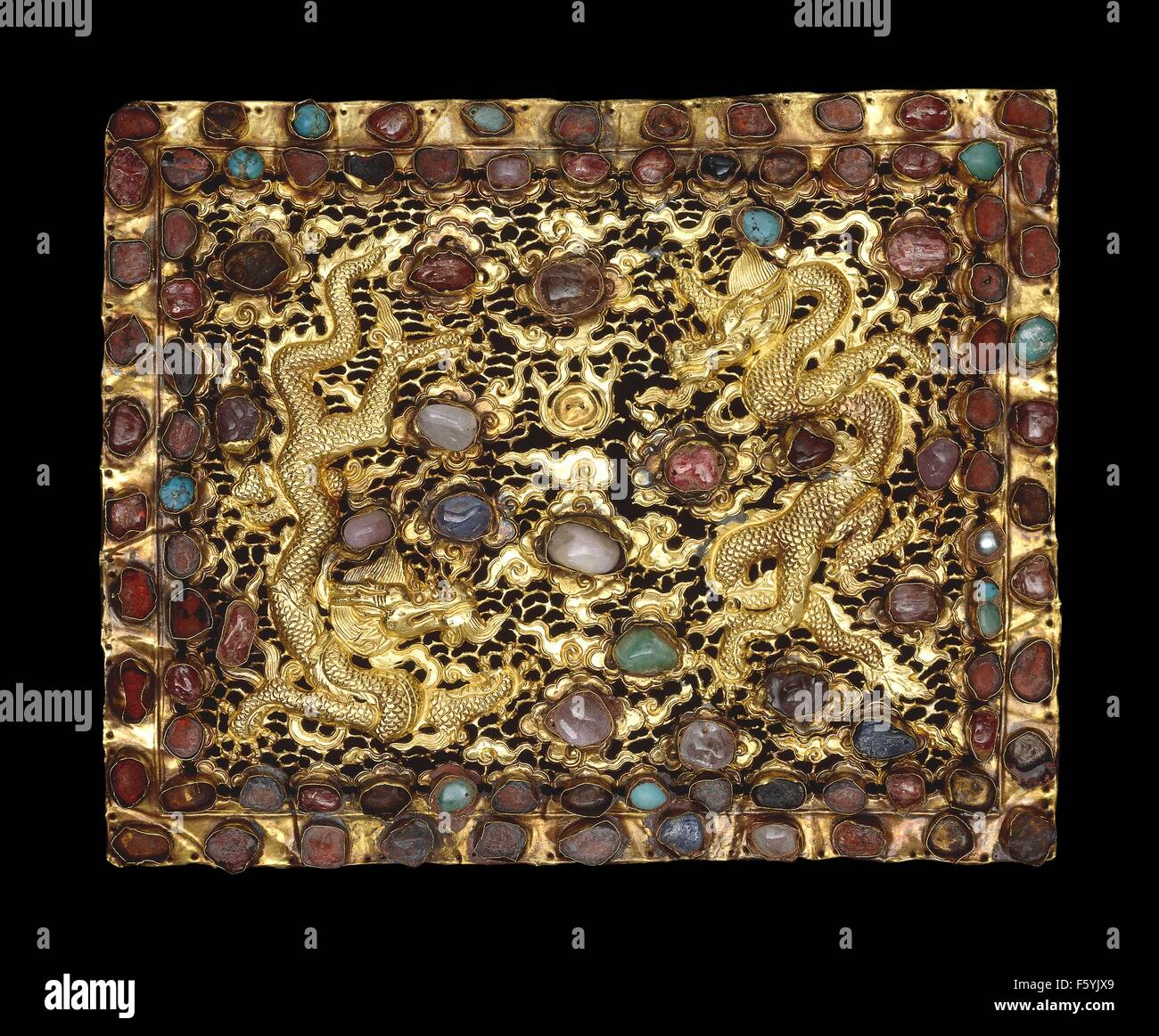 A pair of gold pillow ends, decorated with two dragons and worked in relief with chased detail and openwork. Gold, - Stock Image